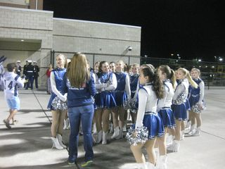 Cheerleaders prepping before the game
